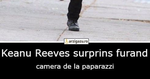 Keanu Reeves surprins furand camera de la paparazzi